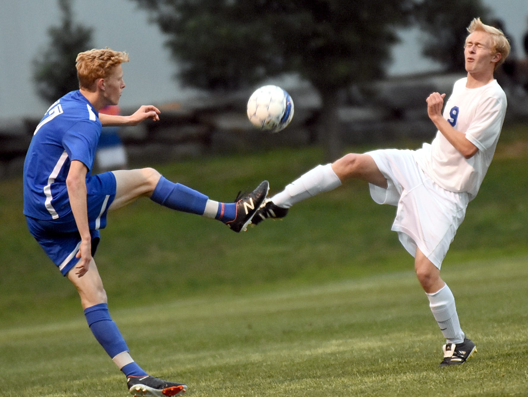 White House High senior defender Matthew Smith battles for possession with Hume-Fogg junior midfielder Travis Brown during first-half action.