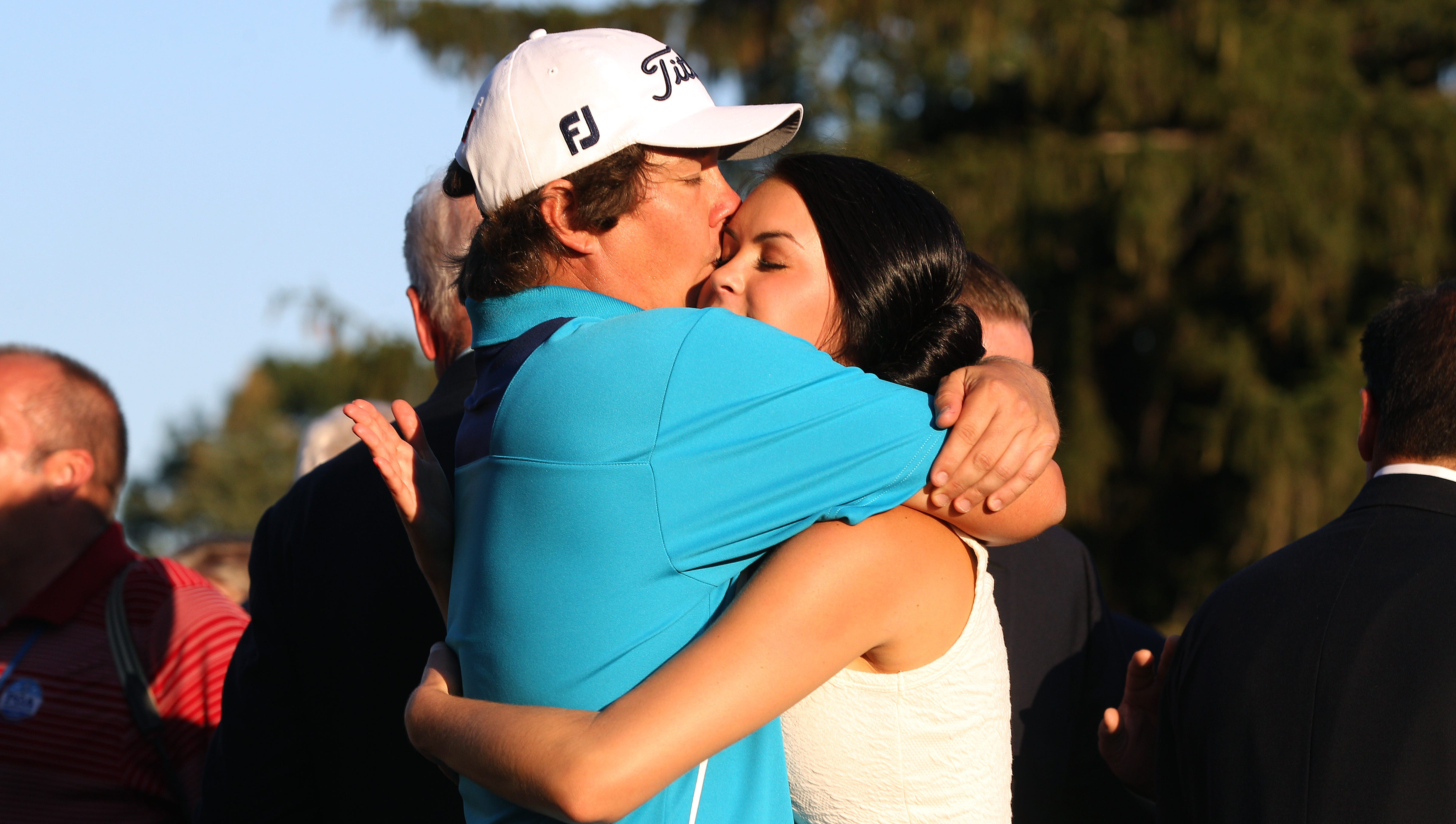 Jason Dufner gets a hug from his wife Amanda after winning the 2013 PGA Championship at Oak Hill Country Club.