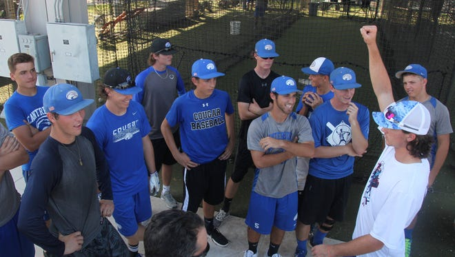 Members of Canterbury's varsity baseball team,  rally at the end of practice at FGCU on Tuesday.