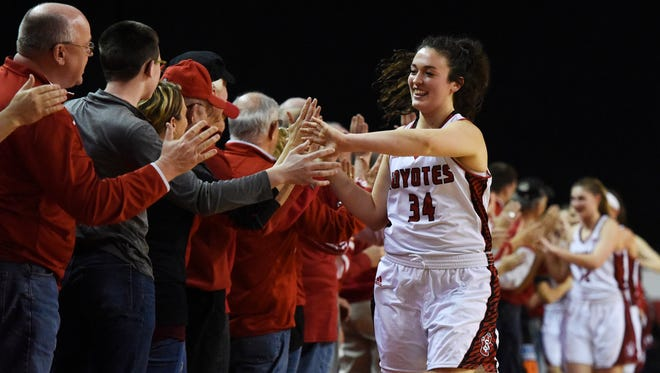 USD's Kate Liveringhouse (34) gives high-fives to fans after their 68-54 win over Western Kentucky Sunday at the WNIT quarterfinal at the DakotaDome, March 27, 2016.
