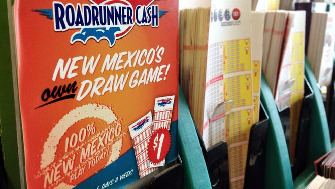 In this May 18, 2017, file photo, lottery forms fill a kiosk at a convenience store in Albuquerque, N.M. New Mexico has taken a big step to provide more certainly for college students about the amount of financial aid they can count on from state lottery revenues.