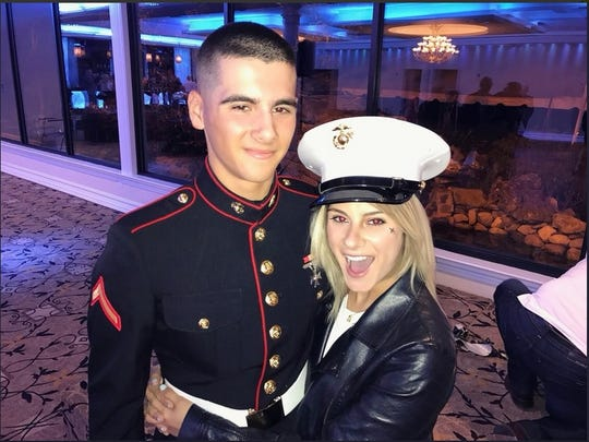 """""""American Idol"""" Jax hugs her brother Matthew, a U.S. Marine. Jax will perform on the Fourth of July in a tribute to the military on the South Lawn of the White House as part of the Hallmark Channel's televised celebration. She intends to sing a new original song, """"Somebody's Kid,"""" she wrote inspired by her family's experience of having a member in the military."""