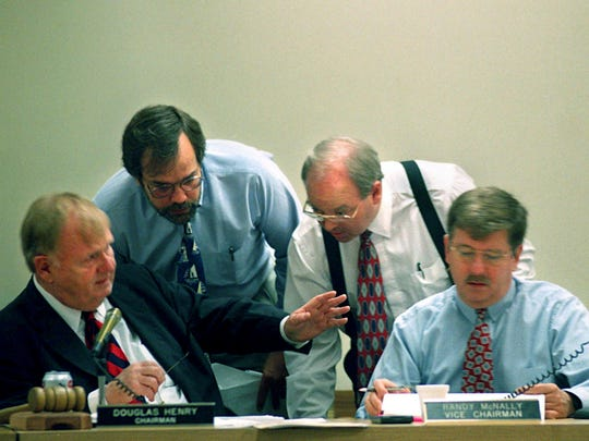 Senate Finance Committee Chairman Douglas Henry, left, and Vice Chairman Randy McNally, right, conduct business while other legislators and assistants give advice May 26, 1997.