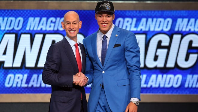 Aaron Gordon (Arizona) poses for a photo with NBA commissioner Adam Silver after being selected as the number four overall.