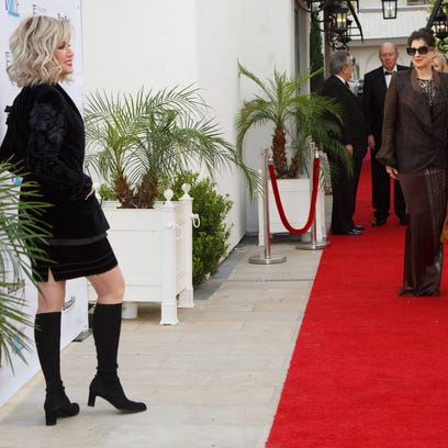 Donna Mills arrives on the red carpet for the Palm