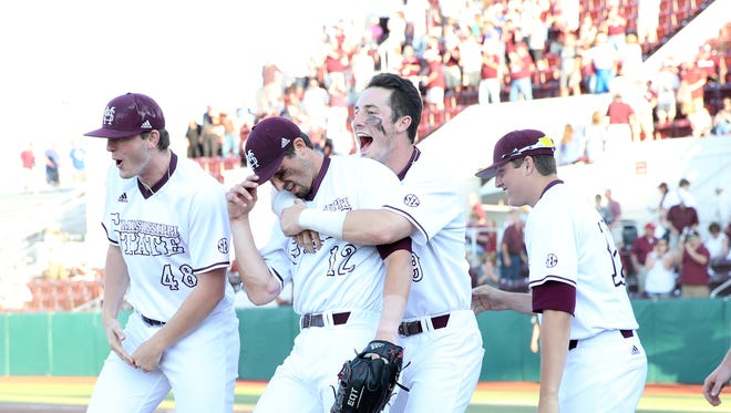 Reid Huphreys (left) and Brent Rooker celebrate Mississippi State's three-game sweep of Missouri on Saturday.