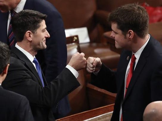 U.S. Rep. Matt Gaetz fist bumps House Speaker Paul