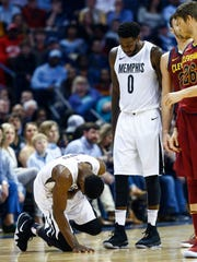 Memphis Grizzlies guard Tyreke Evans (left0 falls to