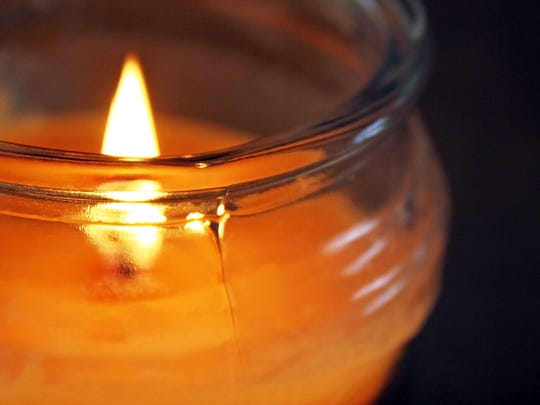 Flame glowing in a scented jar candle
