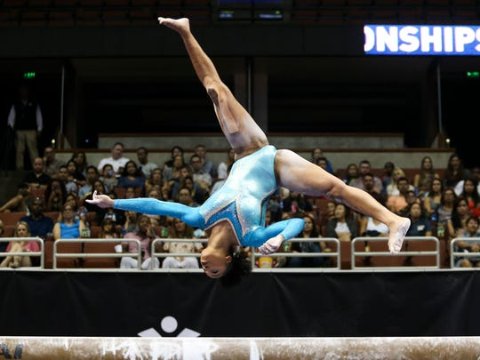 Margzetta Frazier competes on the balance beam during the P&G Gymnastics Championships in Anaheim, California, on Aug. 20.