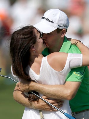 Brendon Todd is kissed by his wife, Rachel, on the 18th green after winning the Byron Nelson Championship.