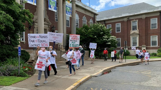 """Newton Public School nurses, who have been working without a contract for a year, protested outside of City Hall on Wednesday. According to union president Sue Riley, the nurses have been offered a raise that's """"close to zero."""""""