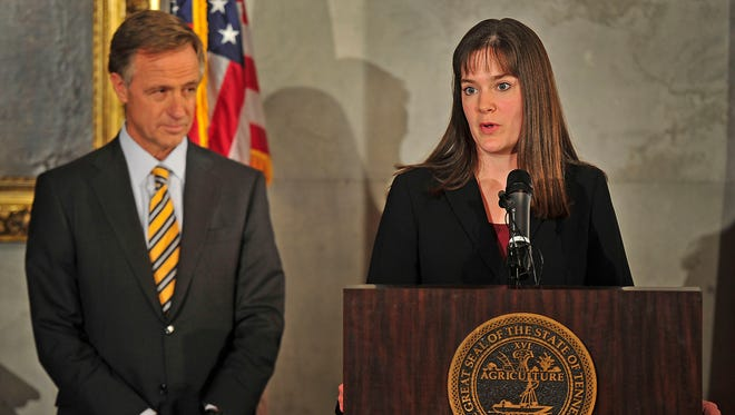 Gov. Bill Haslam announces Candice McQueen as the new education commissioner during a news conference Wednesday, Dec. 17, 2014, at the state Capitol in Nashville.