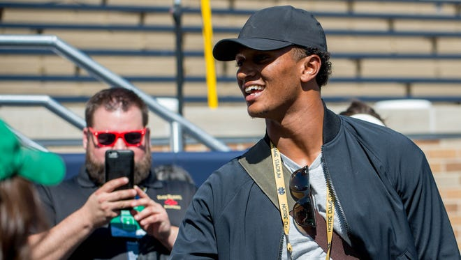 Former Notre Dame Fighting Irish and current Cleveland Browns quarterback DeShone Kizer greets fans before the game between the Notre Dame Fighting Irish and the Temple Owls at Notre Dame Stadium.