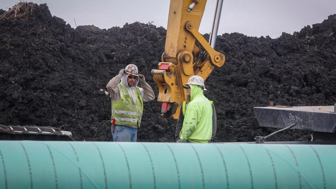 Construction continues on the Dakota Access pipeline on Wednesday, Oct. 26, 2016, at Shirley Gerjets' farm in Rockwell City. Gerjets' farm has been with her family for decades, and she is deeply concerned about the pipeline running through her field, citing eminent domain and oil spillage among her chief concerns.