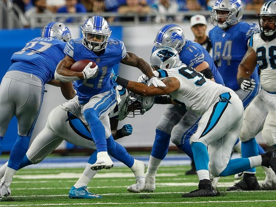 Ameer Abdullah runs the ball in the second half against the Panthers, Oct. 8, 2017.