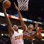 The Suns'  PJ Tucker goes up for a lay-up against the the Bucks' Giannis Antetokounmpo on Dec. 15.
