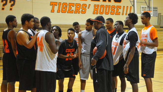 Cocoa High basketball Coach James Rowe in the Cocoa High gym with his team for a 2014 practice.