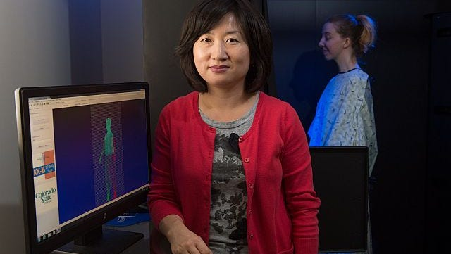 Juyeon Park, Assistant Professor of Design and Merchandising scans graduate student Sara Dudek to redesign standard hospital gowns. May 12, 2014