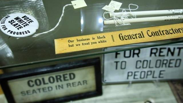 A display of items is seen at the Jim Crow Museum of Racist Memorabilia in Big Rapids, Mich.