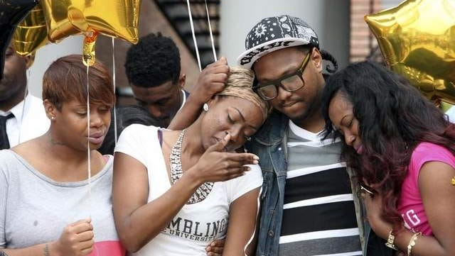 Family members of Alexandria Shelton, the Grambling State University student found deceased in a park in Lafayette on Sunday, comfort one another during a ceremony in honor of Shelton on GSU's campus Thursday.