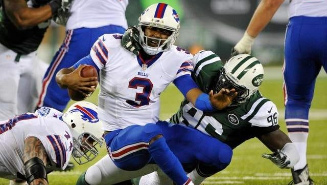 New York Jets defensive end Muhammad Wilkerson sacks Buffalo Bills quarterback EJ Manuel during the teams' first meeting on Sept. 22. Wilkerson has eight sacks this season.