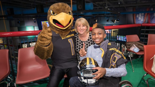 University of Southern Mississippi mascot Seymour and Mississippi first lady Deborah Bryant congratulate the state's 2018 Children's Miracle Network Hospitals Champion KJ Fields at an announcement at the Mississippi Sports Hall of Fame.