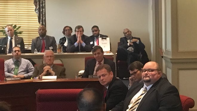 Delaware Attorney General Matt Denn (center) listens to a question during his department's budget hearing on Wednesday.