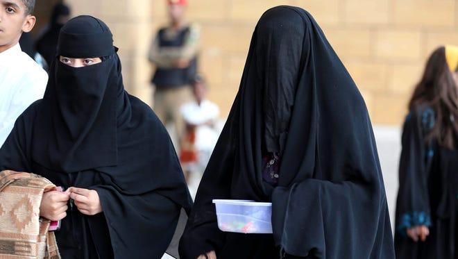 Saudi women arrive at a mosque to perform the Eid al-Adha morning prayers, Riyadh, Saudi Arabia, on Oct. 3, 2014.