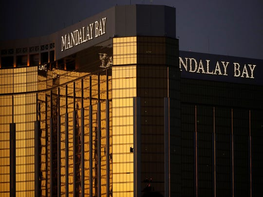 Windows are broken at the Mandalay Bay resort and casino, Tuesday, Oct. 3, 2017, in Las Vegas. Authorities said Stephen Craig Paddock broke the windows and began firing with a cache of weapons, killing dozens and injuring hundreds. Credit: John Locher/Associated Press