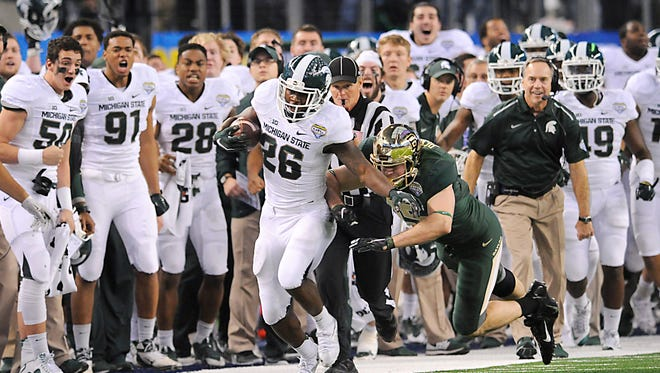 Head coach Mark Dantonio, right, and the rest of the Spartans react as MSU's R.J. Williamson runs back a  kick blocked by the MSU defense into Baylor territory in the last minute of the Spartan's  come-from-behind  42-41 victory over Baylor in the Goodyear  Cotton Bowl Classic  at AT & T Stadium in Arlington, TX, on Thursday, Jan. 1, 2015.   MSU later scored to tie and win.