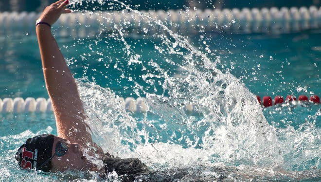 Claire Toomey takes the lead in the 100 medley relay during a Champlain Valley Swim League meet in Essex Thursday night, July 2, 2015.