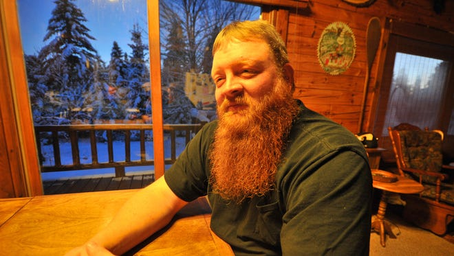 Jeremy Wilcox's 9-inch red beard has become a sensation after Aaron Rodgers gave it a little good-luck tug on the sidelines of Sunday's Packers game against the Detroit Lions.