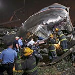 Emergency personnel work May 12, 2015, at the scene of a derailed Amtrak train in Philadelphia.