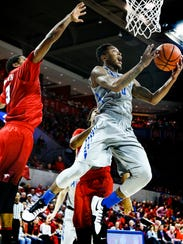 University of Memphis guard Markel Crawford drives