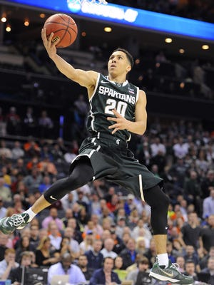 MSU's Travis Trice puts in a layup after a breakaway against Virginia during the first half of their NCAA tournament game Friday in Charlotte, N.C. Trice made his first five shots and scored 13 of MSU's first 17 points.