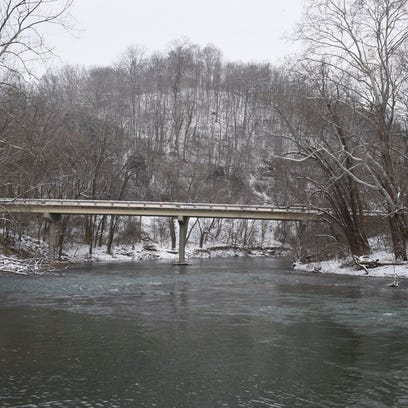 The Harpeth River flows at Newsom's Mill with snow