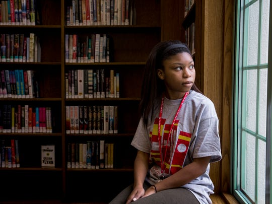 Akira Underwood, 14, of Westwood, poses for a portrait at Westwood Branch Library Saturday, February 25, 2017. Her dream job is to be a librarian and she had the opportunity to work at the Westwood Branch Library.