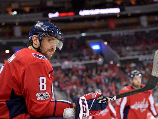 Washington Capitals left wing Alex Ovechkin (8), of Russia, looks on during a break in the action in the first period of an NHL hockey game against the Columbus Blue Jackets, Saturday, Dec. 2, 2017, in Washington. (AP Photo/Nick Wass)