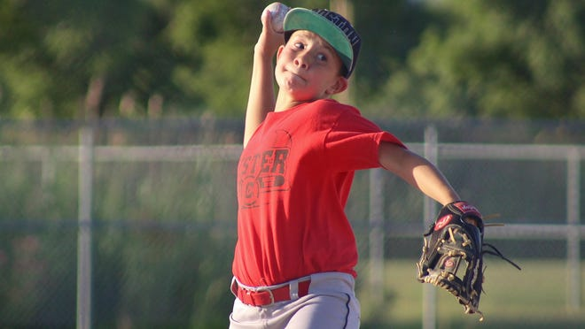 Nicholas Hopper pitches for the Custer Red team during the final day of games Wednesday for the Boys 11-12 Major League. Custer was one of the few summer youth leagues around the Monroe County Region to play ball during the coronavirus pandemic.