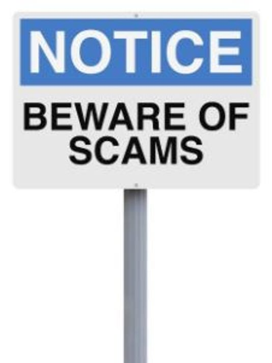 -scams-sign.JPG