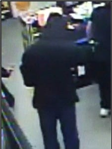 Police are still looking for this robbery suspect, who was last seen wearing a black face mask, black hooded jacket, black gloves, black shoes with white soles and blue jeans at the Pittsville Dollar General.