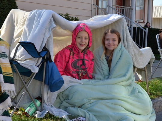 Amber Hummel, left, and Alea Bowma, both of Myerstown, brave the morning chill in their blanket fort while watching the Community of Lebanon Association's 39th annual Holiday Parade on Saturday, Nov.  21, 2015.