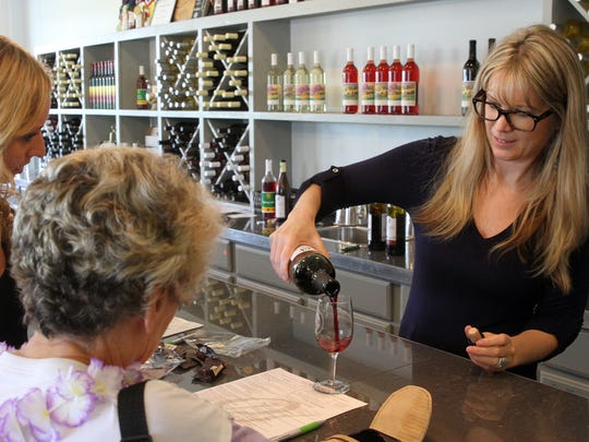 Laurin Dorman, a sommelier at Old York Cellars, pours