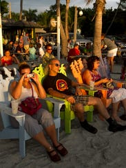 Guests watch the sunset at The Mucky Duck on Captiva.