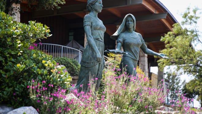 """The statue """"Las Dos Angelas"""" along the Concho Riverwalk by the San Angelo Visitor Center."""