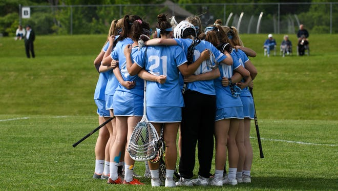 South Burlington huddles together during the girls lacrosse game between the South Burlington Wolves and the Champlain Valley Union Redhawks at CVU High School on Wednesday afternoon June 6, 2018 in Hinesburg.