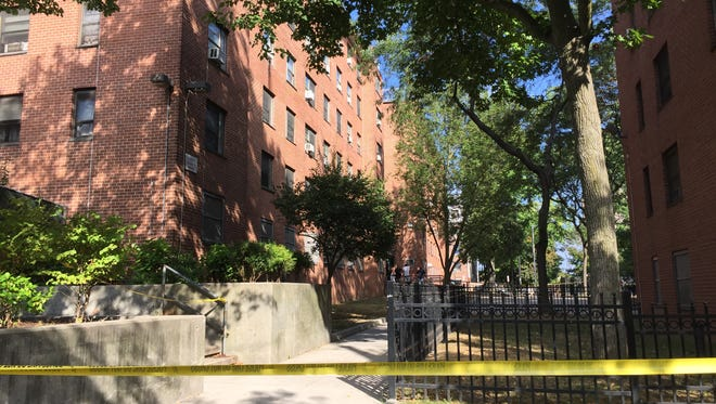 The scene after a man died when he plunged from 361 Main St. in New Rochelle onto a walkway, Sept. 9, 2015.