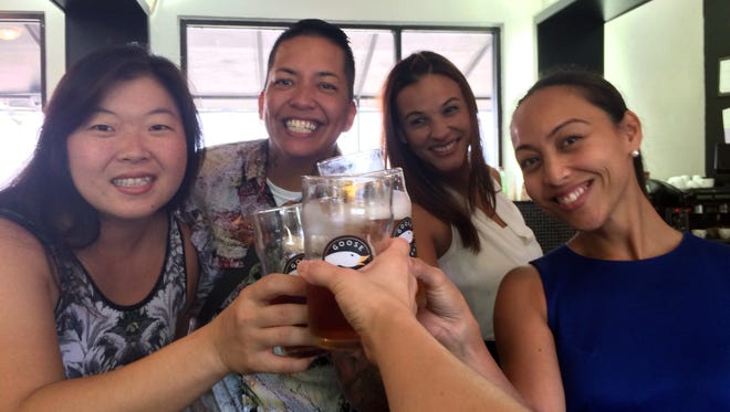 From left, Sue Lee, Dee Cruz, Kamia Dierking and Regine Biscoe Lee toast to craft beers and motherhood at Ture in East Agana on Sept. 9.