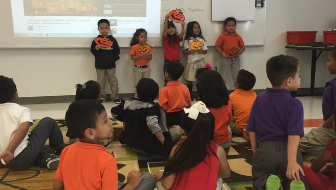 Mission Ridge Elementary School kindergarteners sing a pumpkin song in music class on Oct. 26.